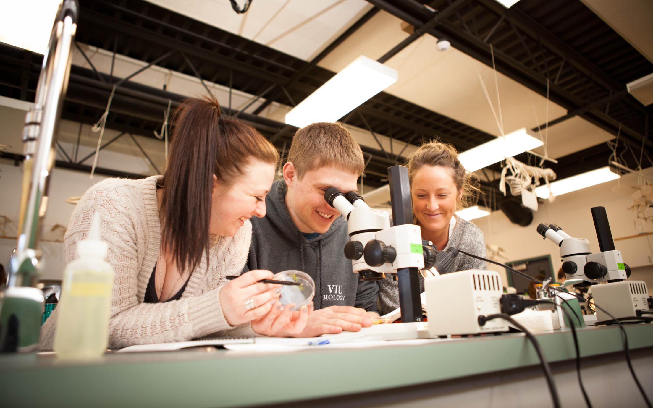 Students of the Bachelor of Arts, Major and Minor in Biology working with a microscope