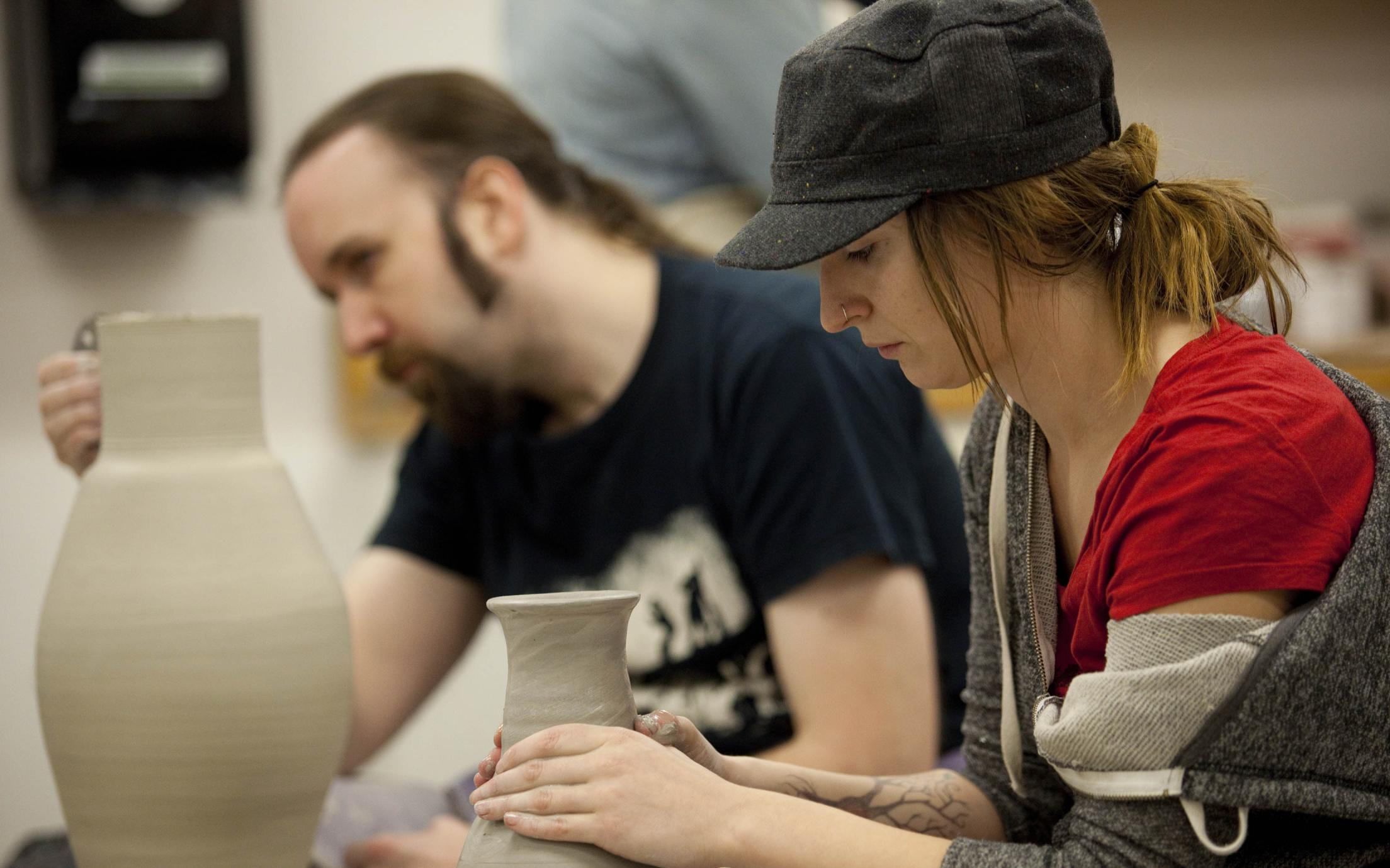 Visual Arts students attending a pottery class