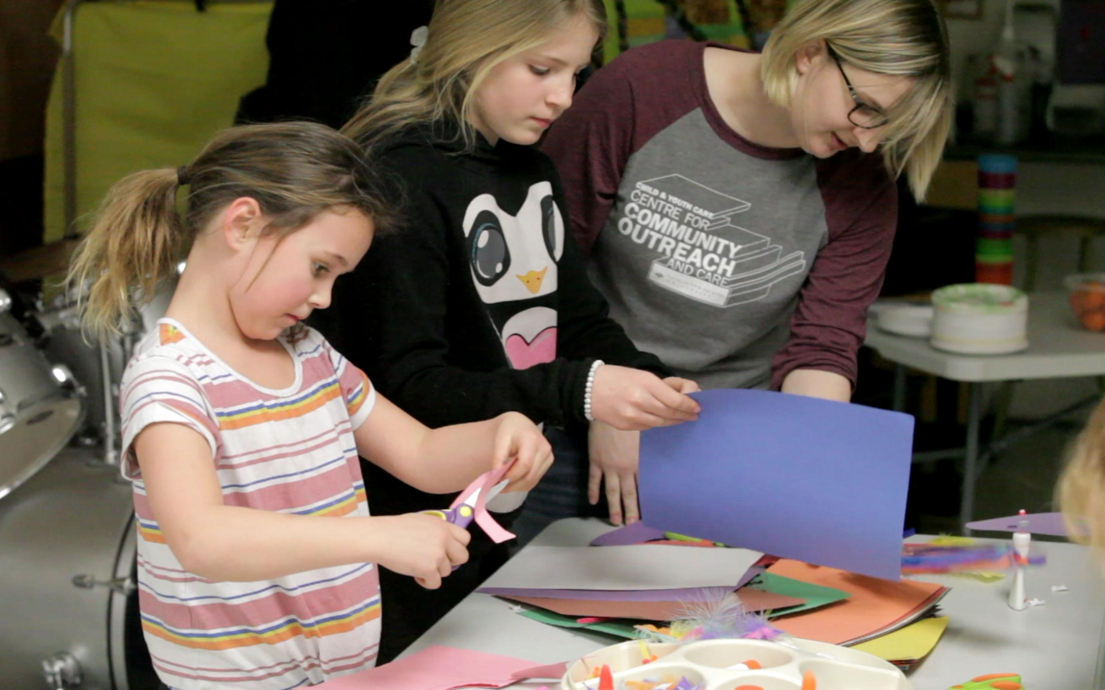 A Student of the Bachelor of Arts in Child and Youth Care program working with two girls