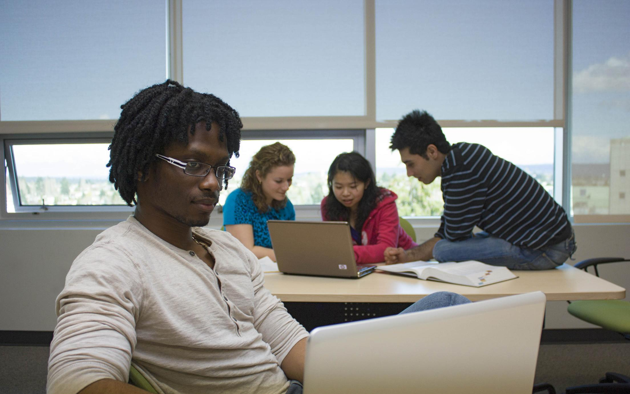 Students of the Bachelor of Arts, Minor in Mathematics program working on a paper