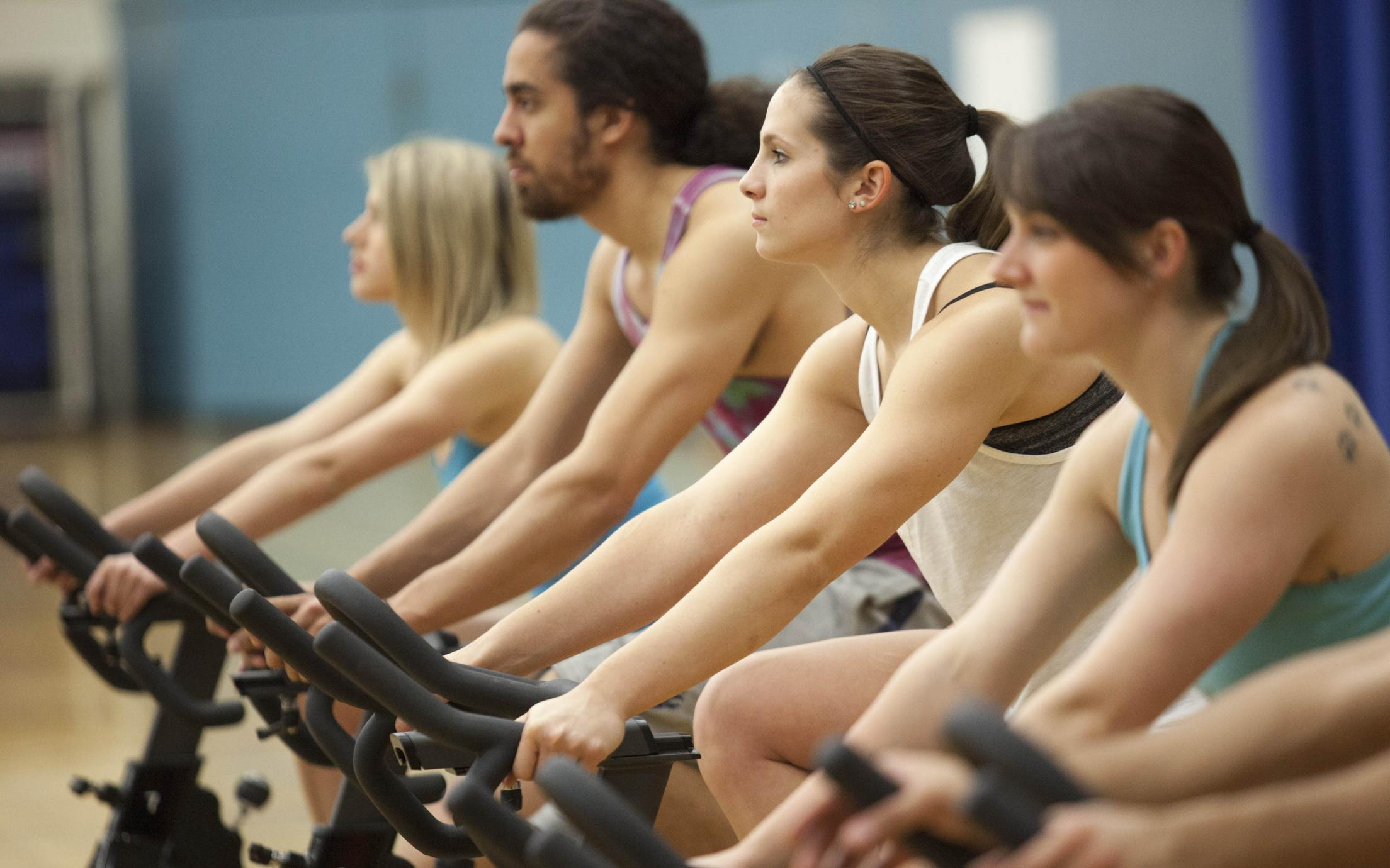 VIU's bachelor of physical education students taking an indoor cycling class