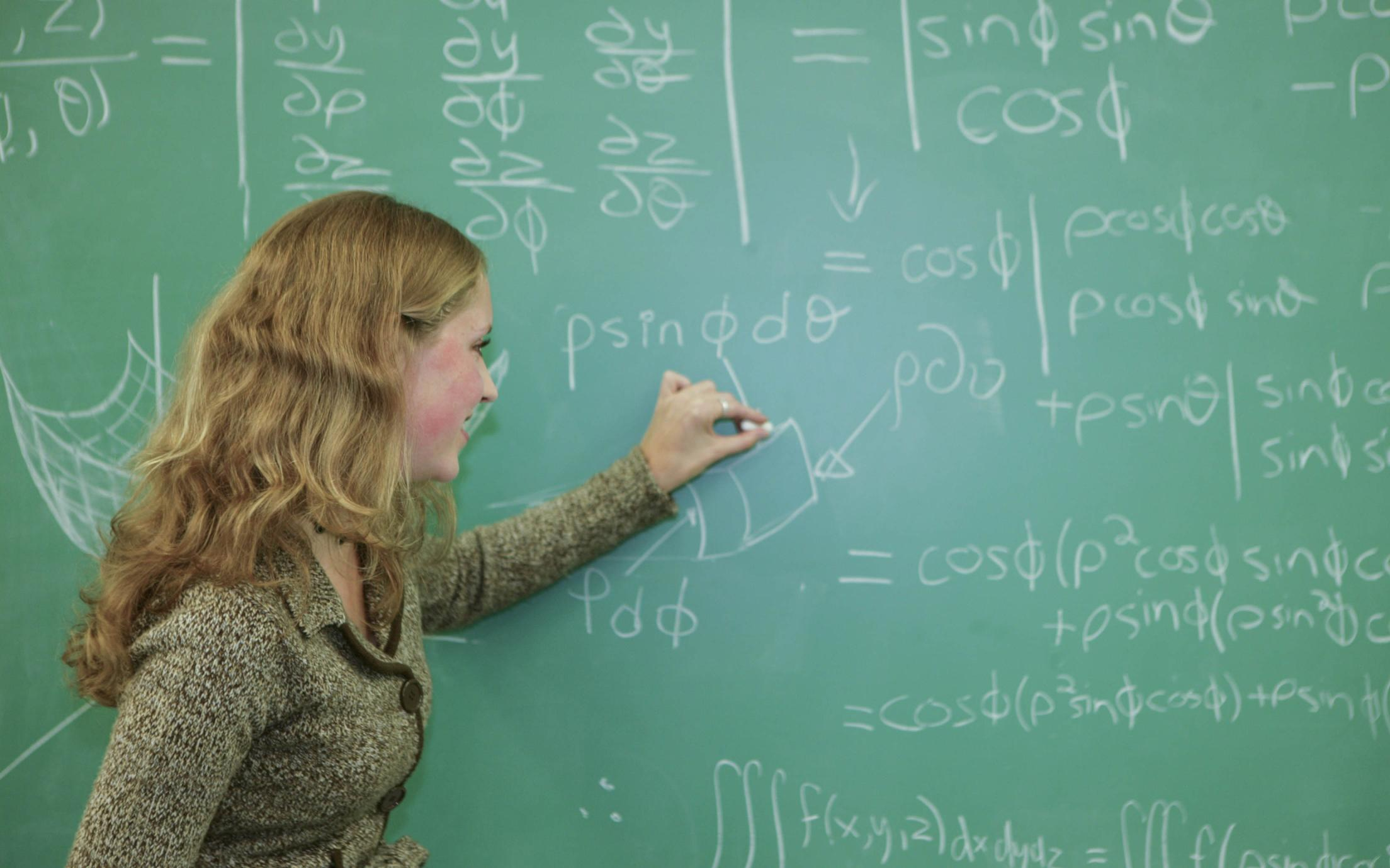 An instructor of the Bachelor of Science, Minor in Mathematics program explaining a calculation