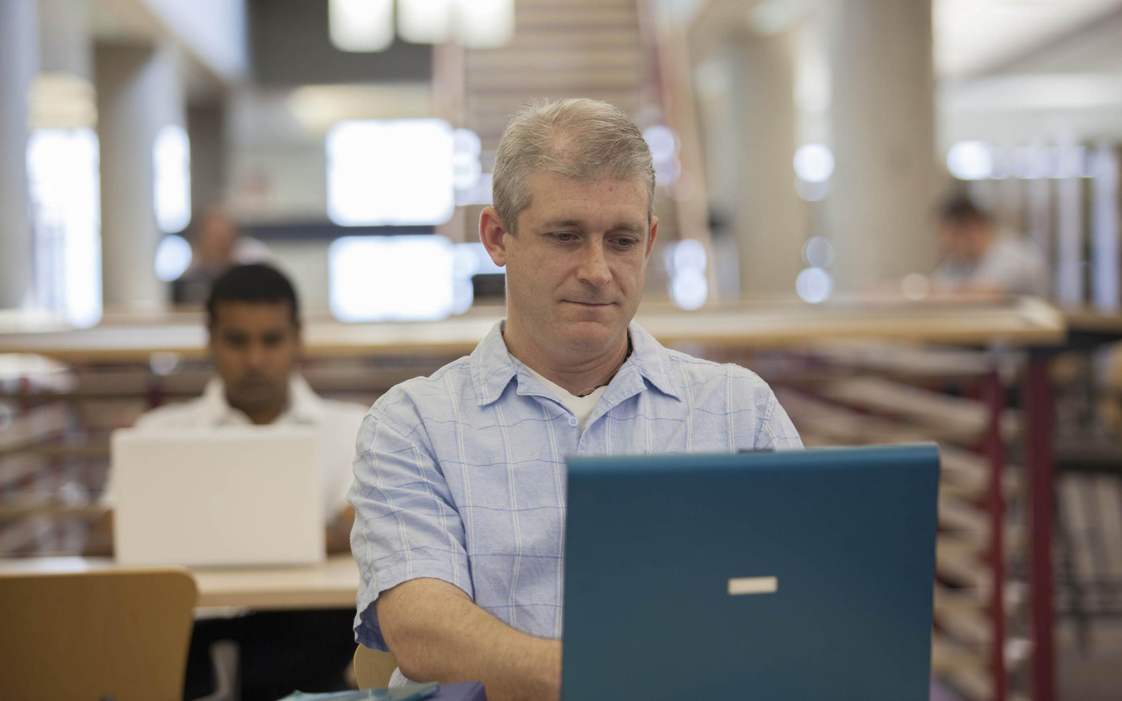 A Student of the BC Adult Graduation Diploma in the library
