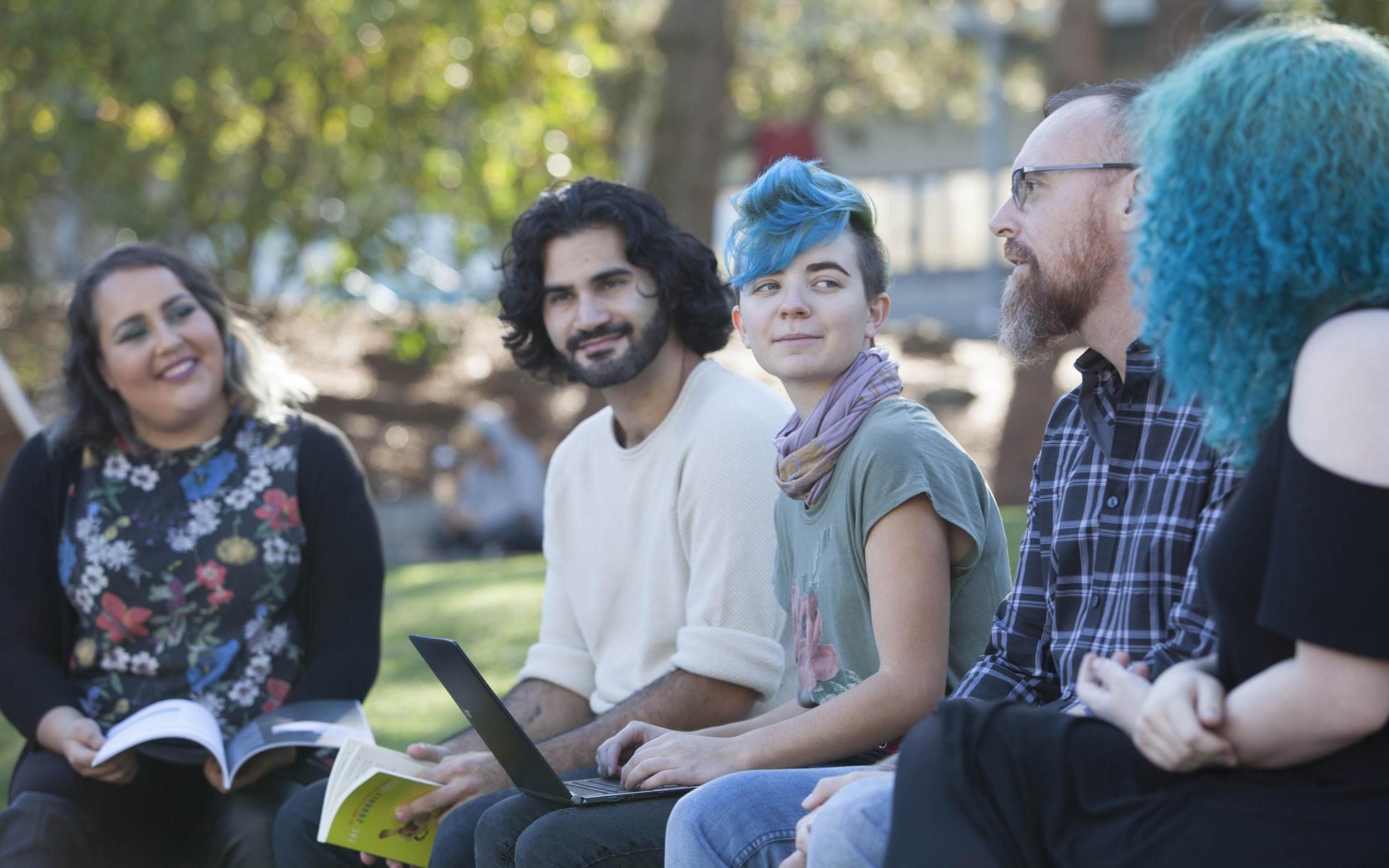 Degree in Journalism students having an outdoor workshop