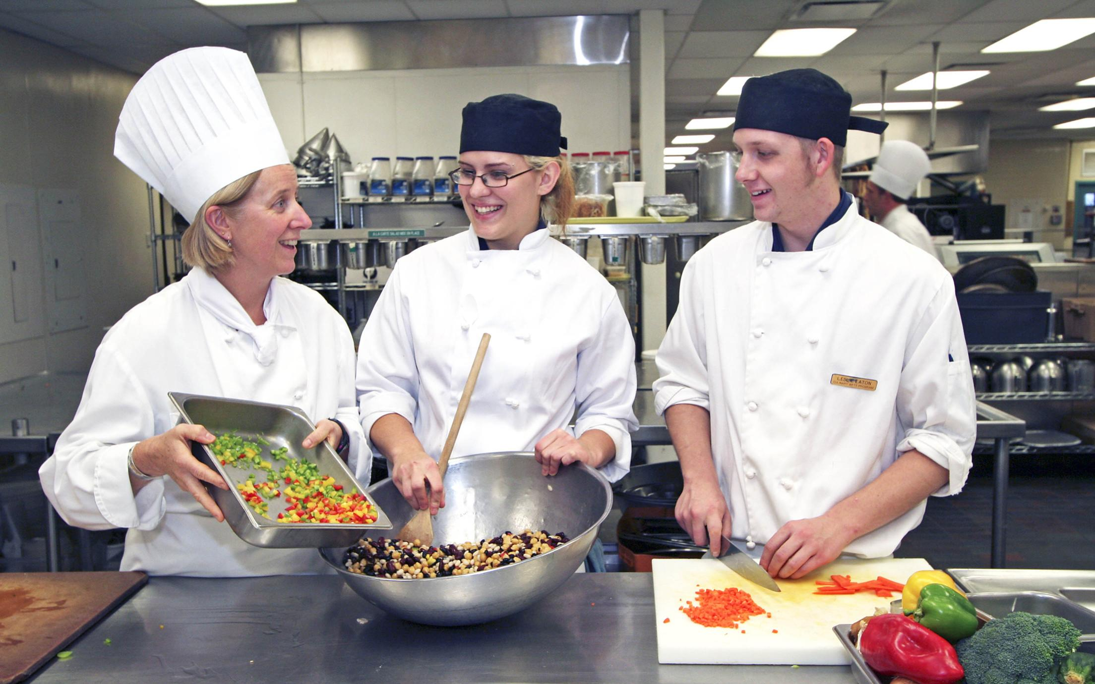 Three students of the Culinary Arts program at VIU's Culinary School