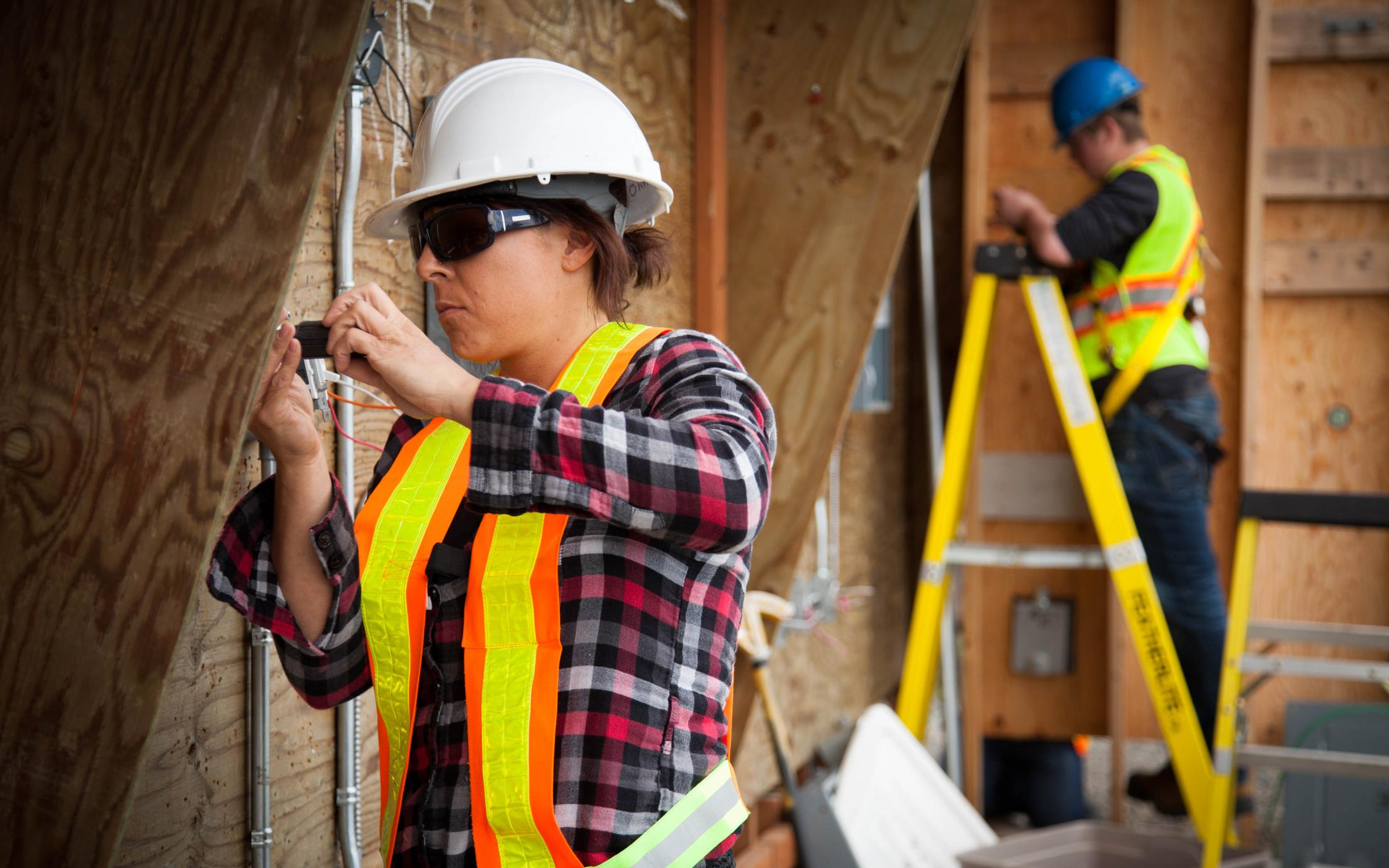 A female Electrical Apprenticeship students working on a construction site