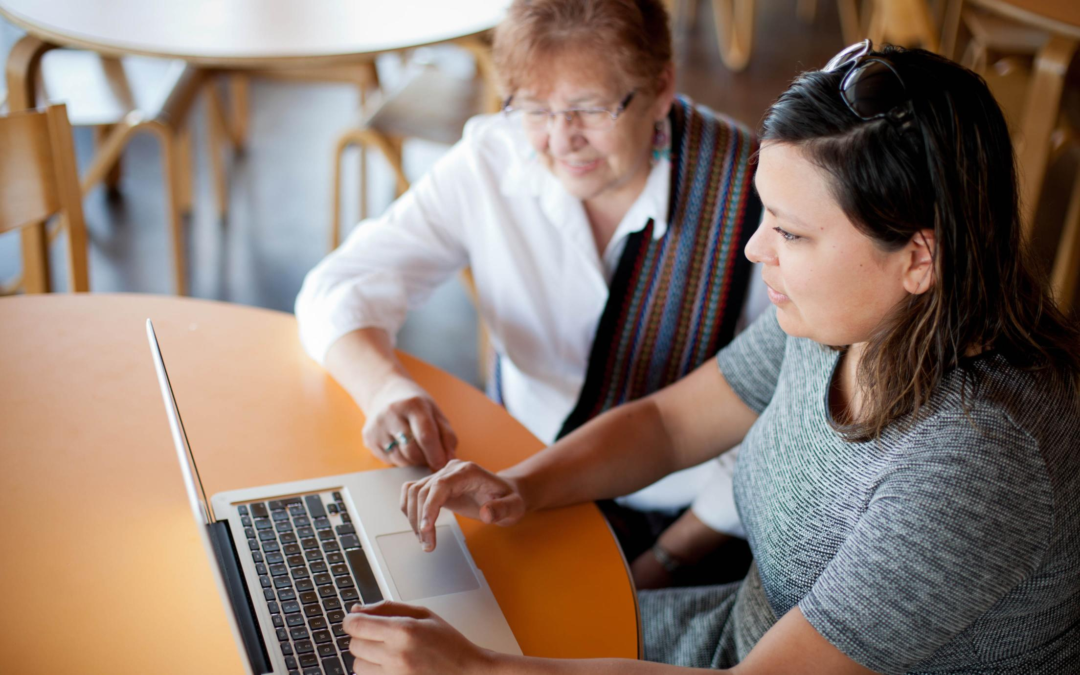 The First Nations Housing Manager providing advice to an elderly woman