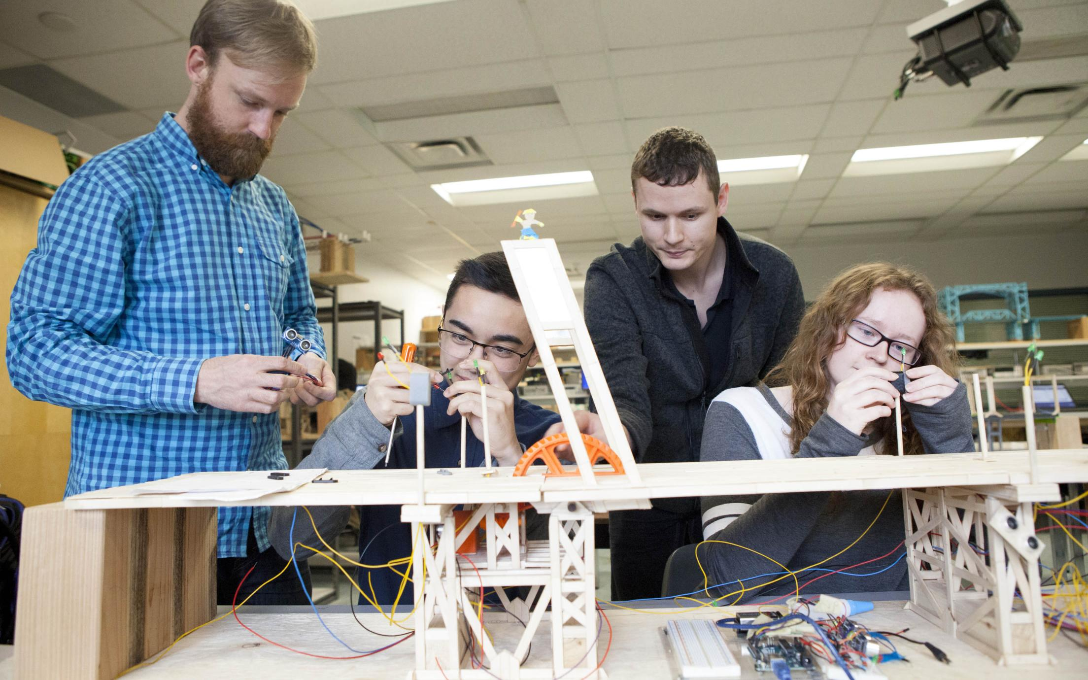 Students of the Fundamentals of Engineering Certificate Program working on a project