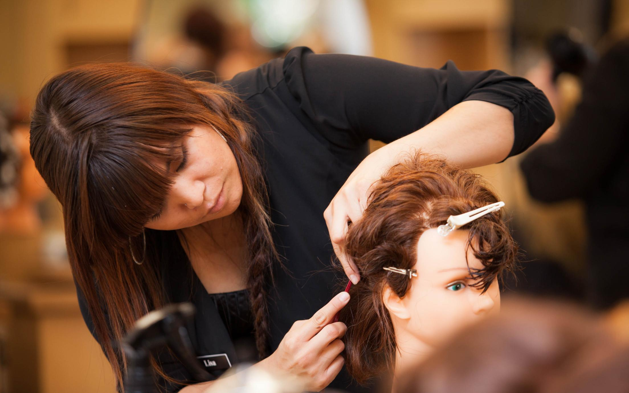 A Hair Stylist course student at VIU's hairdressing school