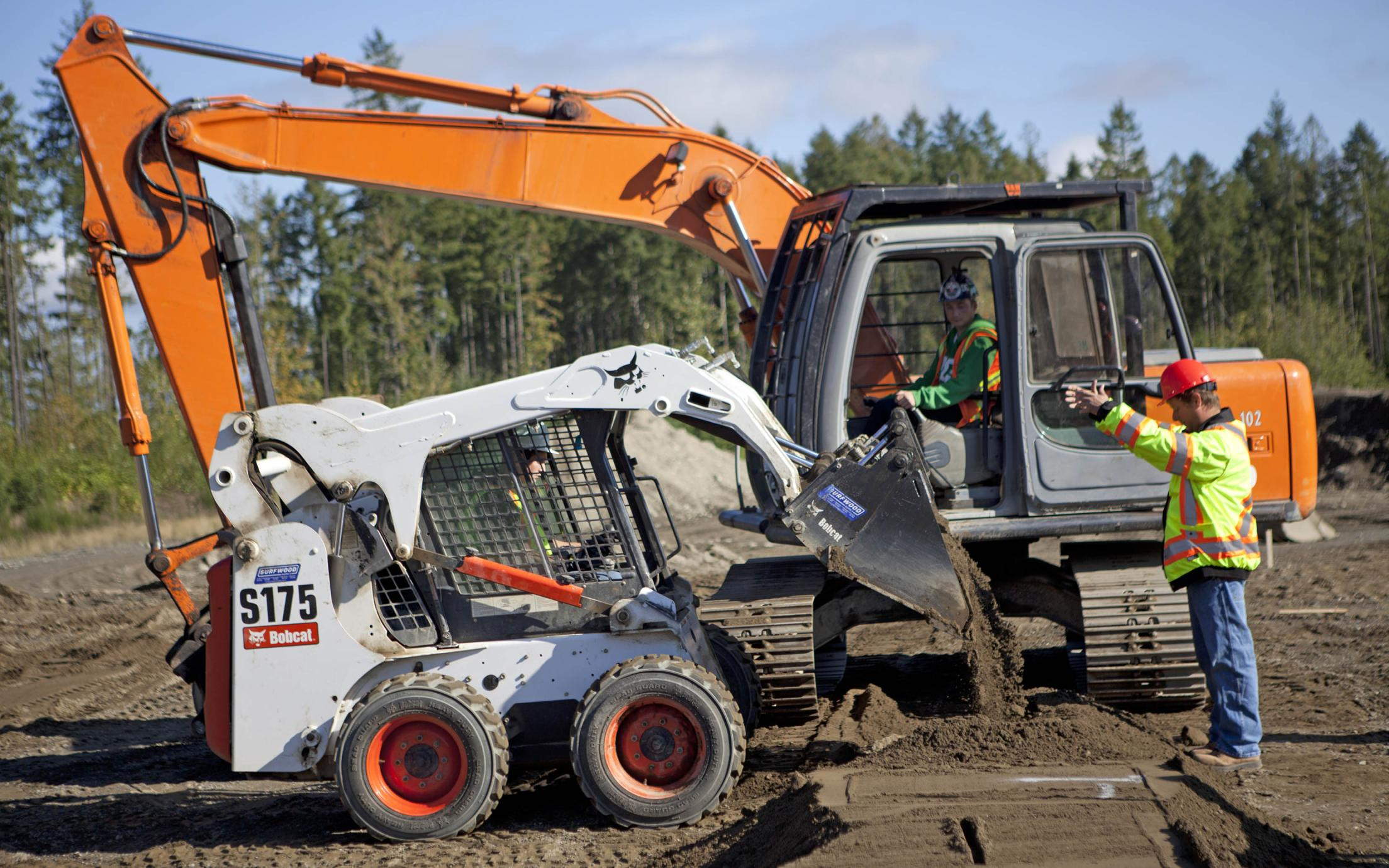 Vancouver Island University's Heavy Equipment Operator courses' students working on a construction site at the school for heavy equipment operators