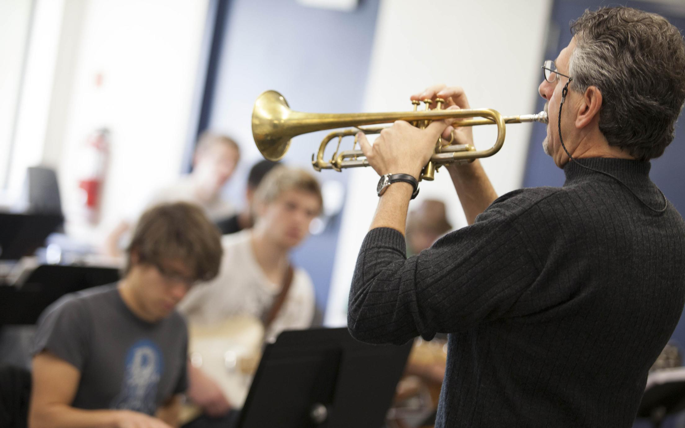 An instructor of the Music - Diploma in Jazz Studies program playing a trumpet