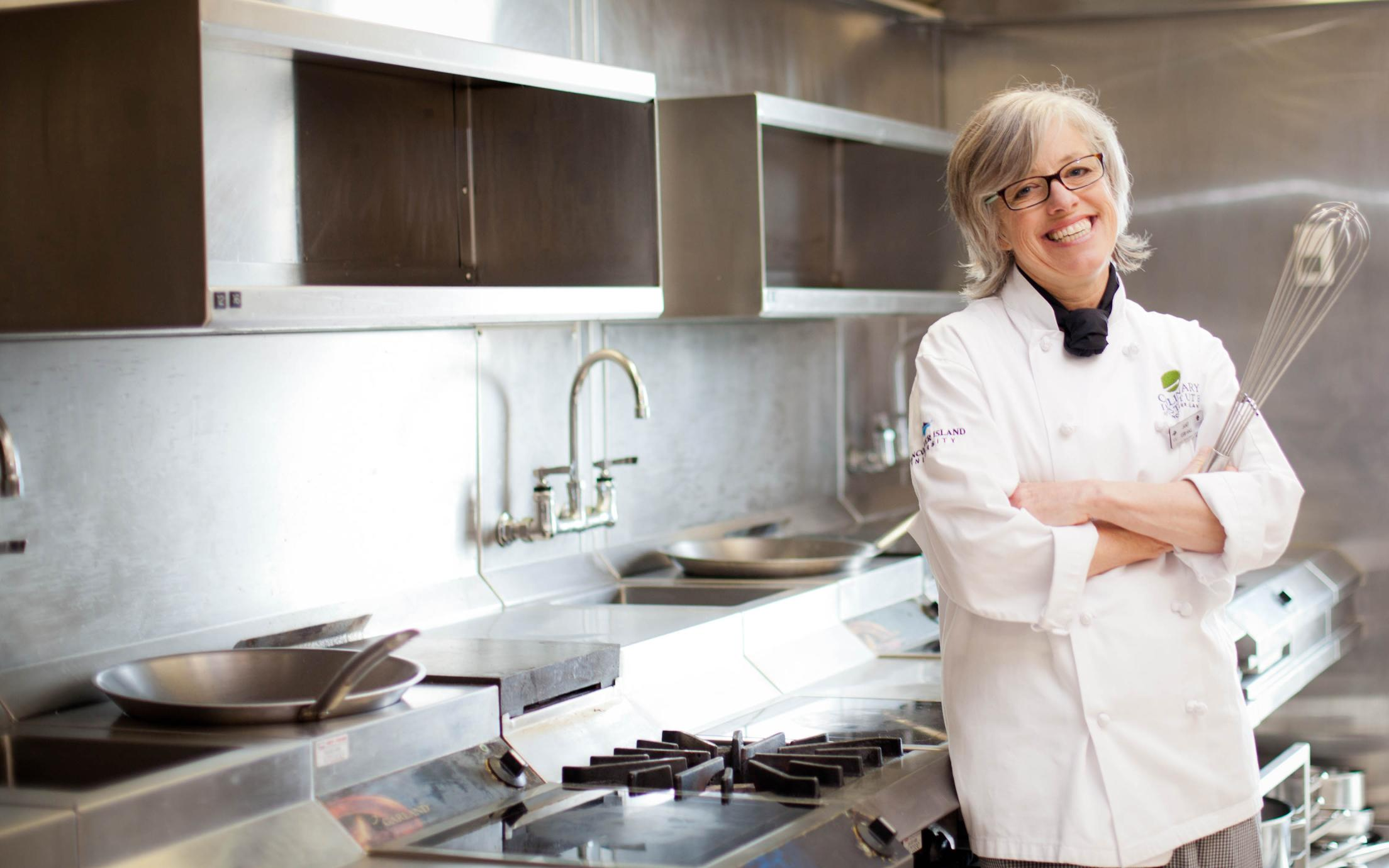 Culinary Management Diploma Student, Janet Kerr-Hall, in the kitchen of VIU's Culinary Institute