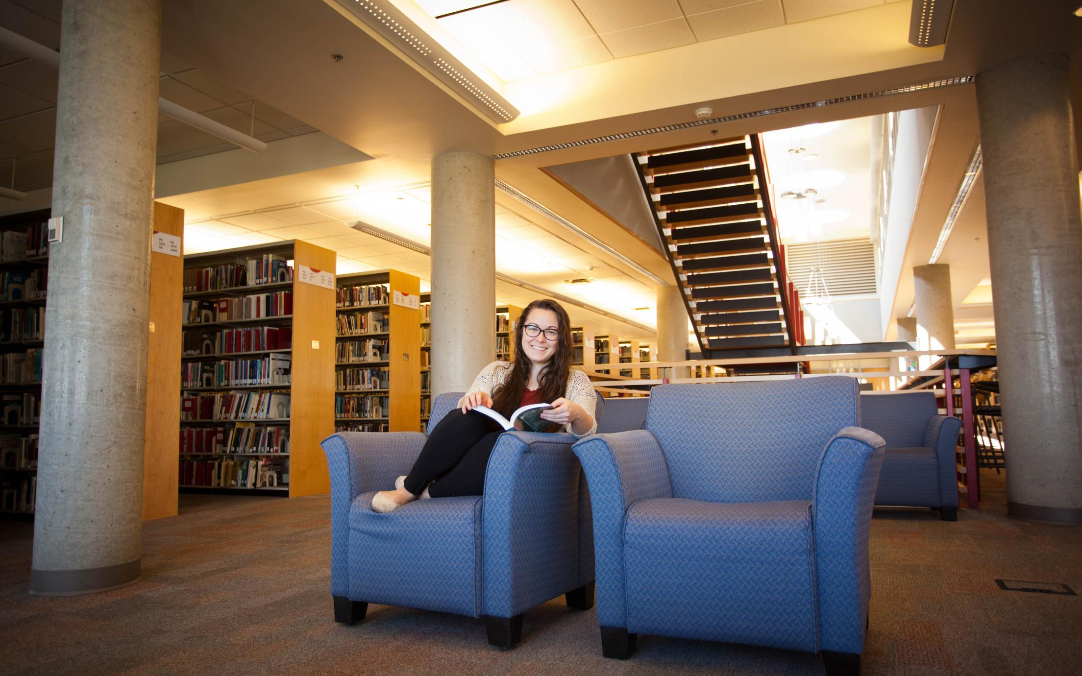 "VIU""s Bachelor of Design in Graphic Design Student, Karlee Takasaki, in the library"