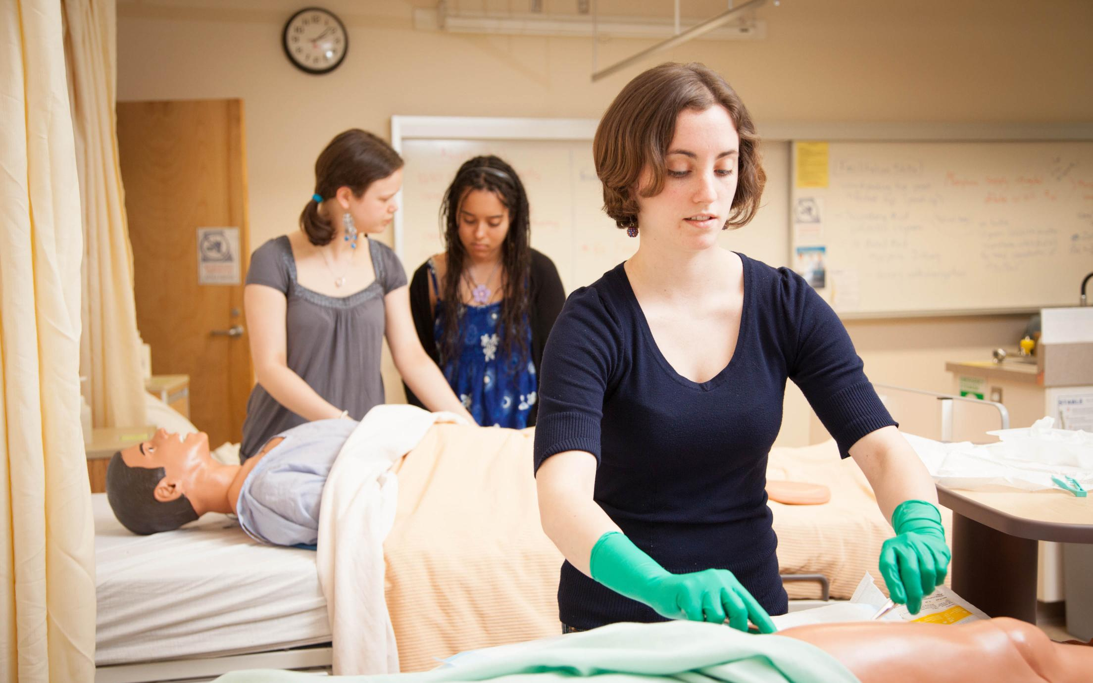A student of the LPN program in BC examining a torso model