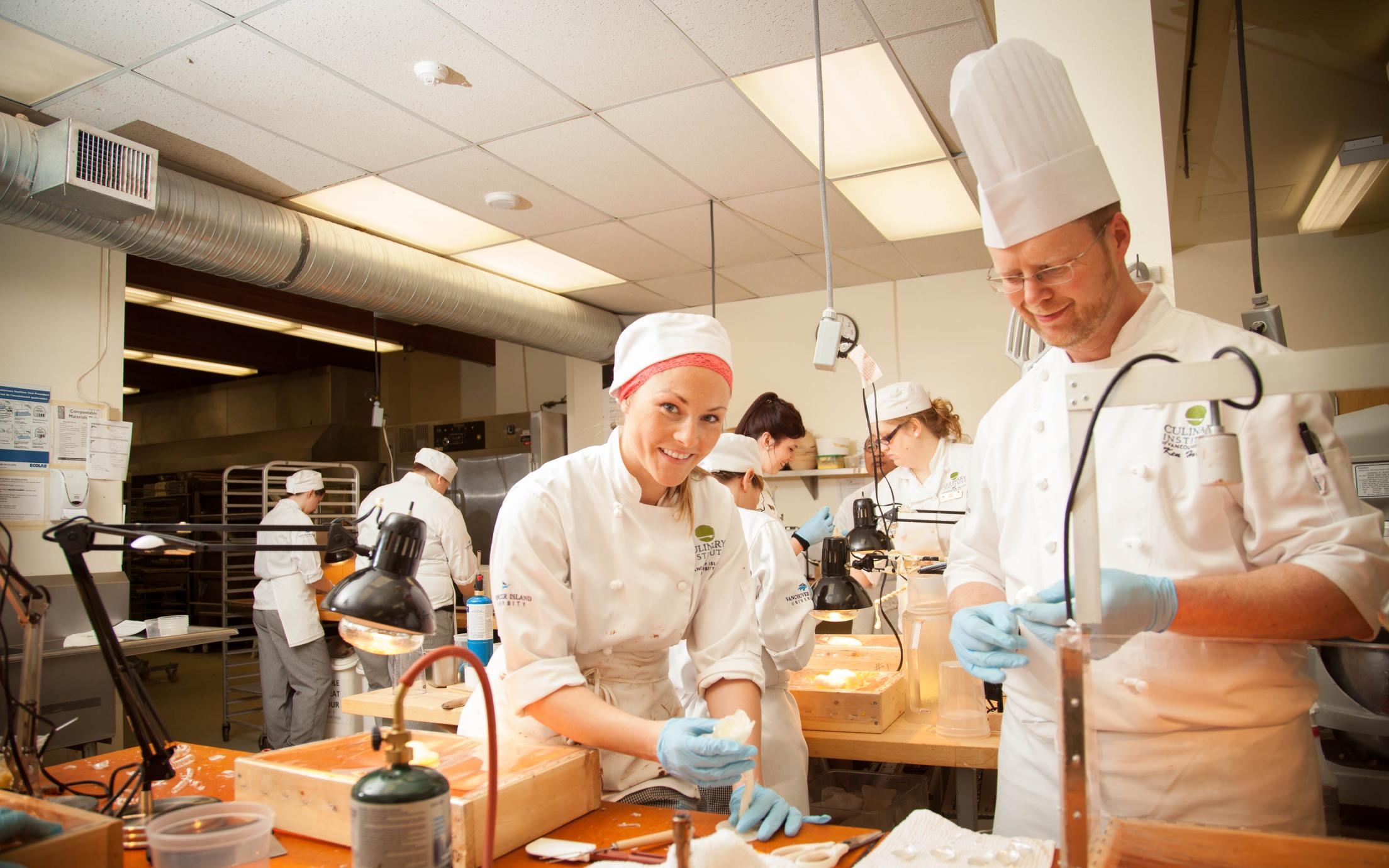 Students of the Professional Baking and Pastry Arts program decorating tasty treats at VIU's baking school