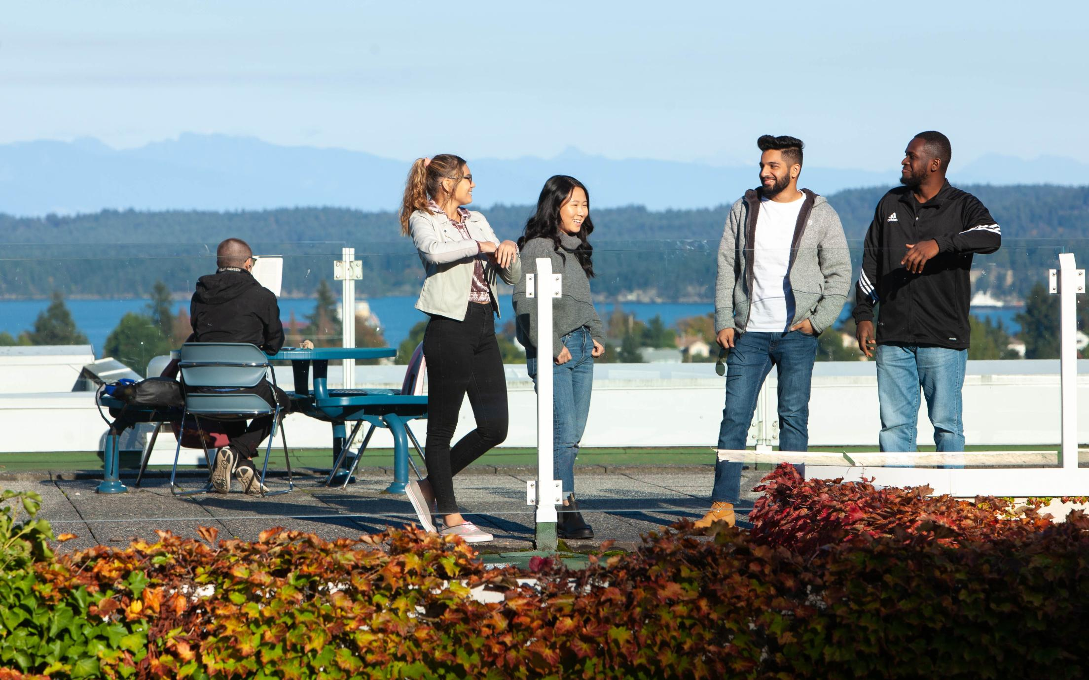 Students chatting on the roof of Building 300, VIU Nanaimo campus
