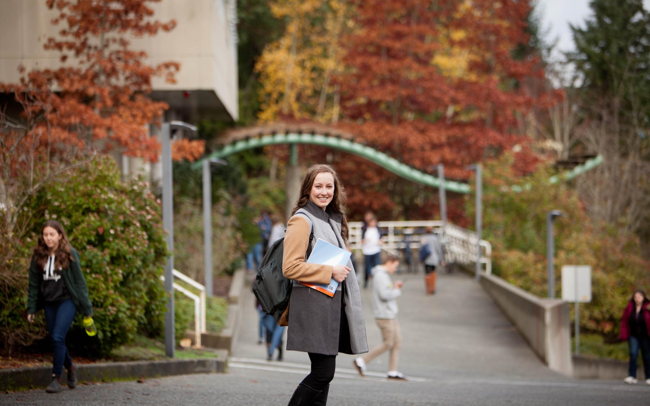 A female Social Services Program student on her way to class