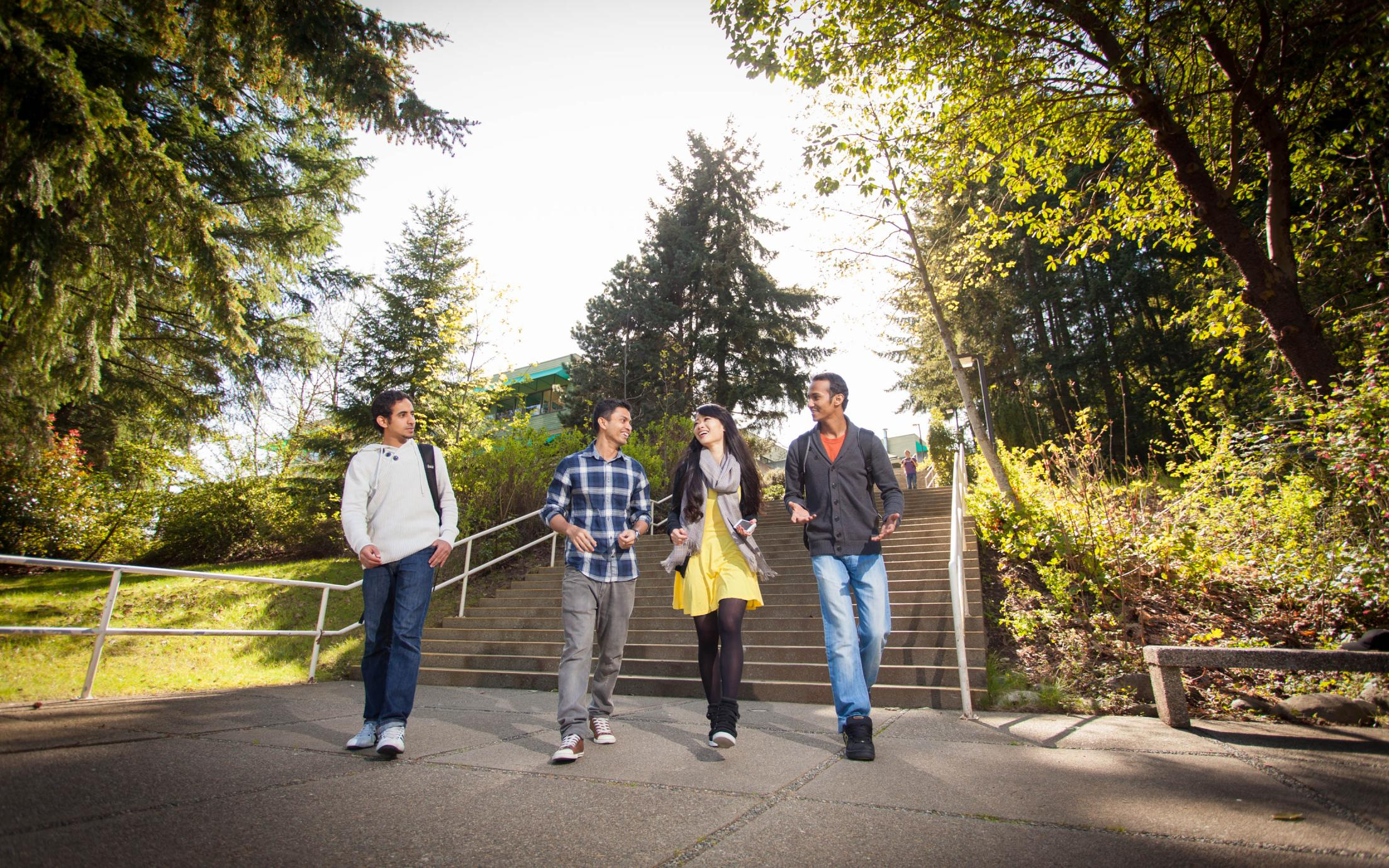 A group of female and male Special Education Teacher Specialty Post Degree Diploma (SETS) students strolling around on campus