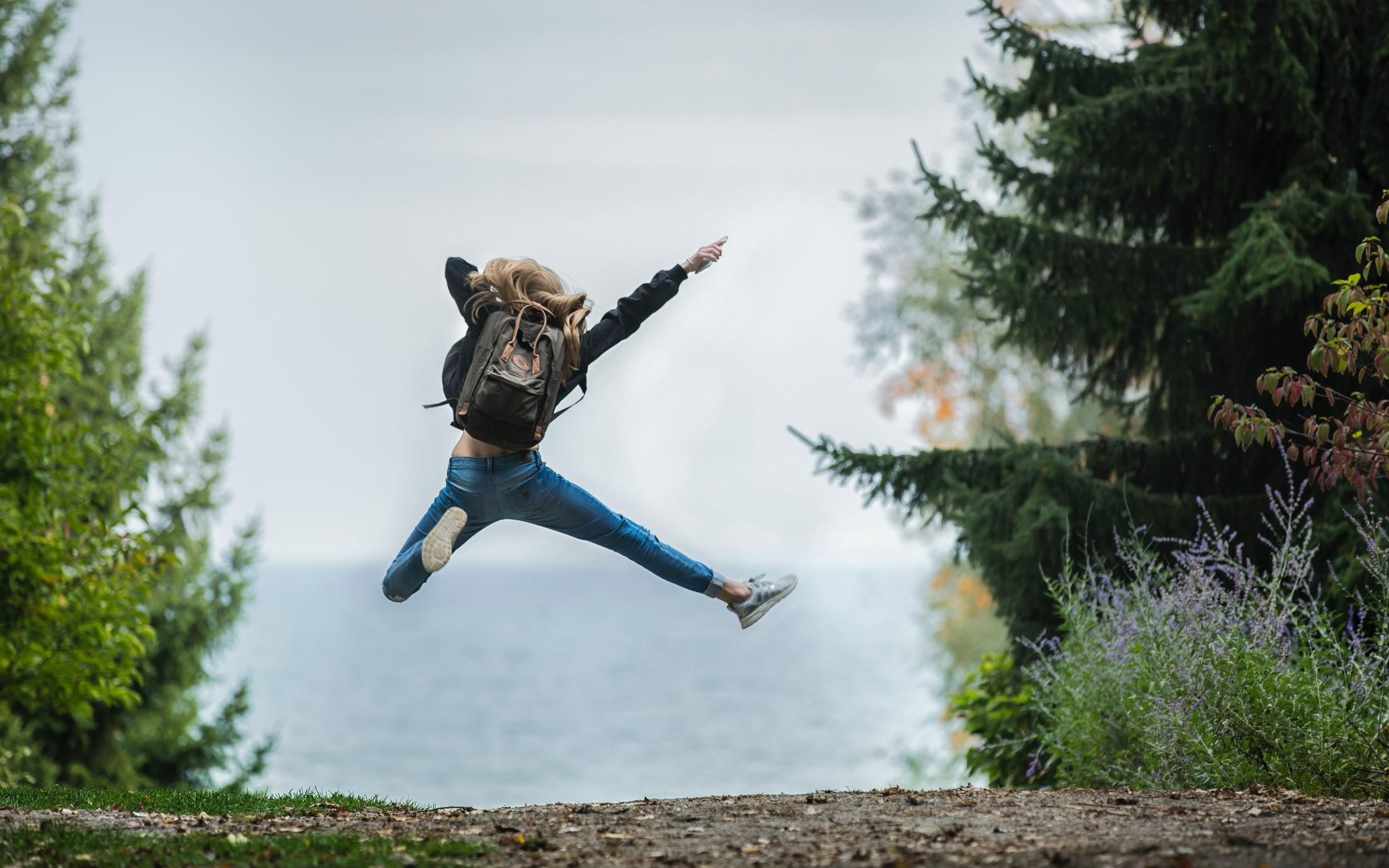 Student jumping in trees