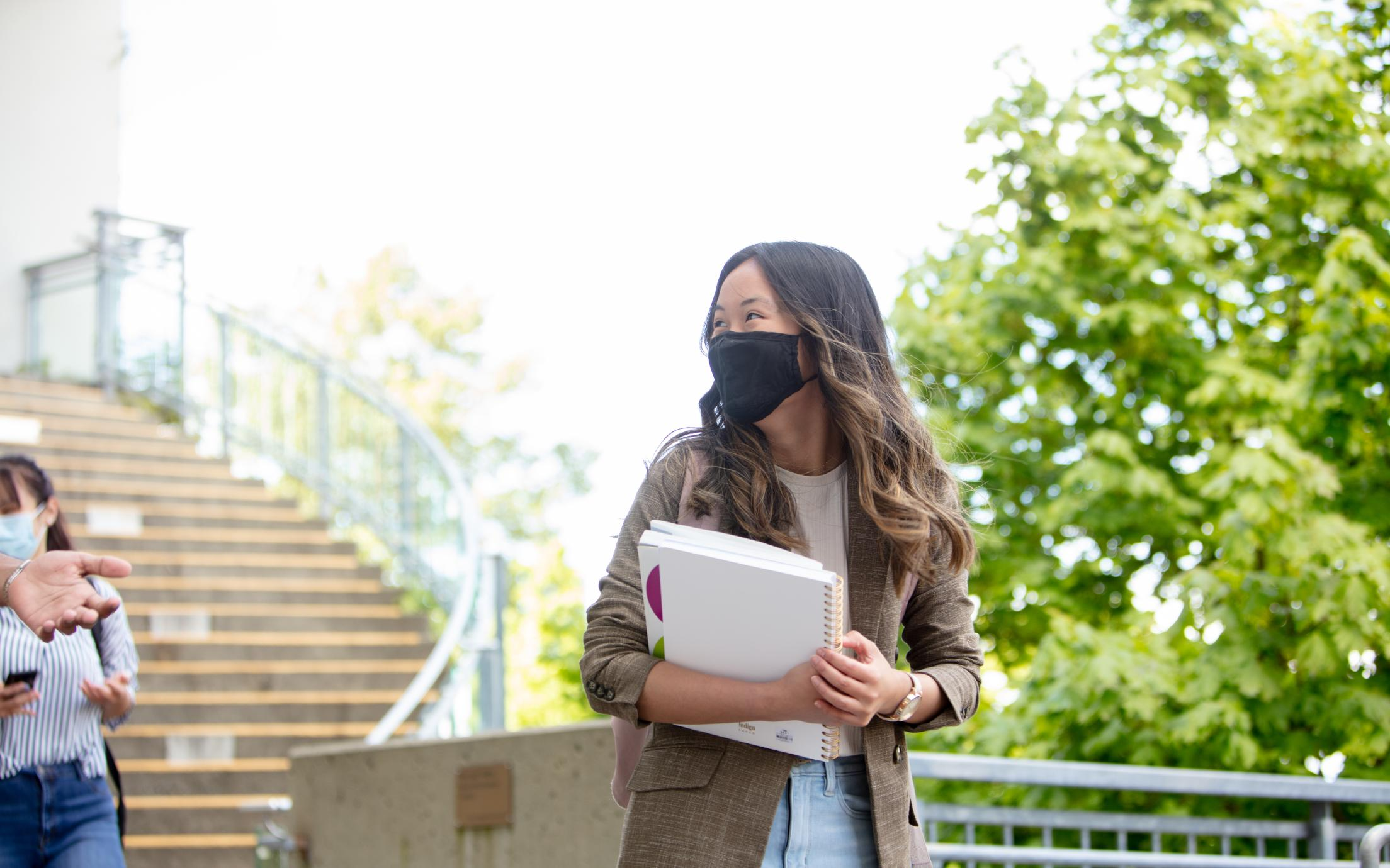 VIU students wearing mask by the library