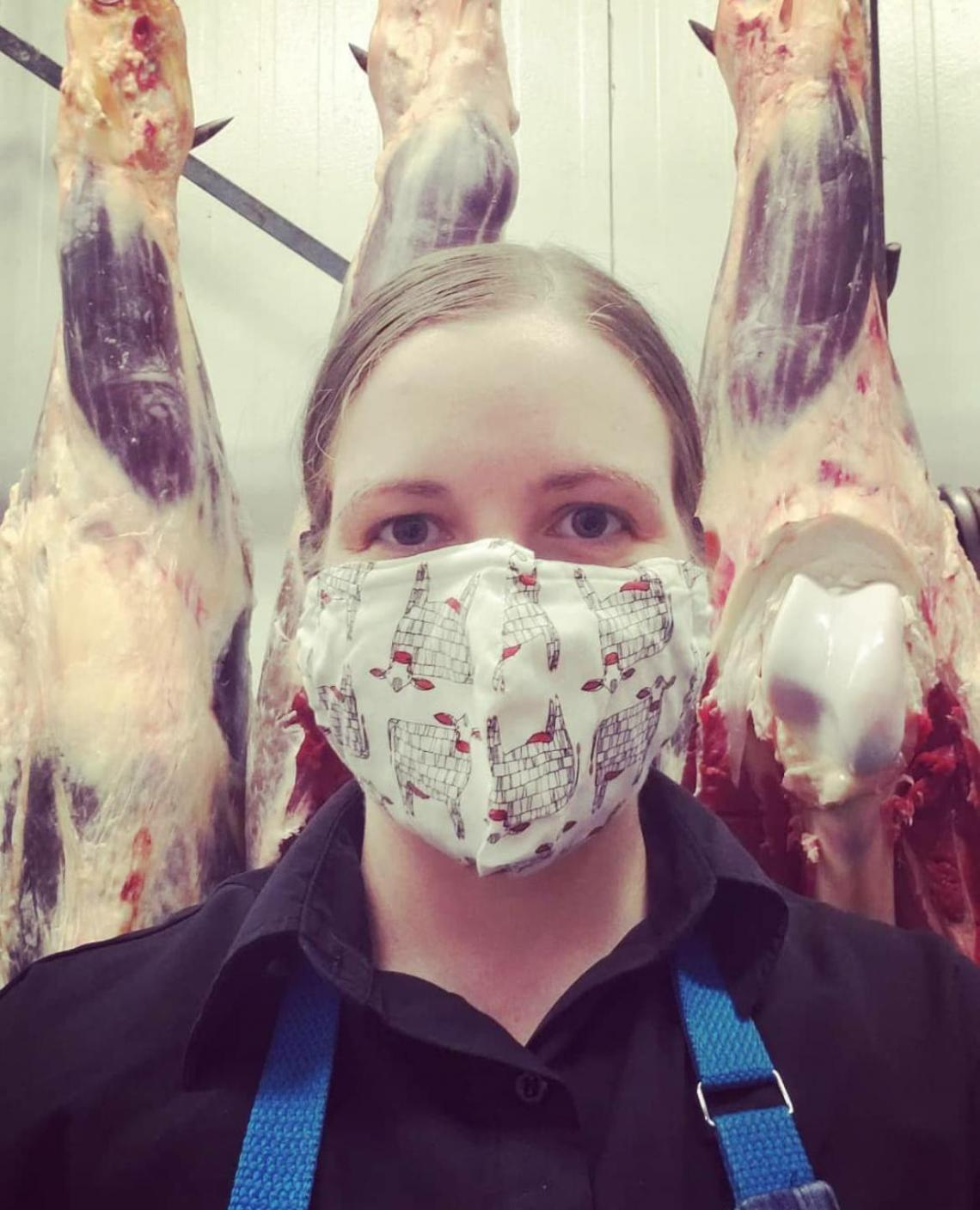 Girl wearing mask in a butcher shop