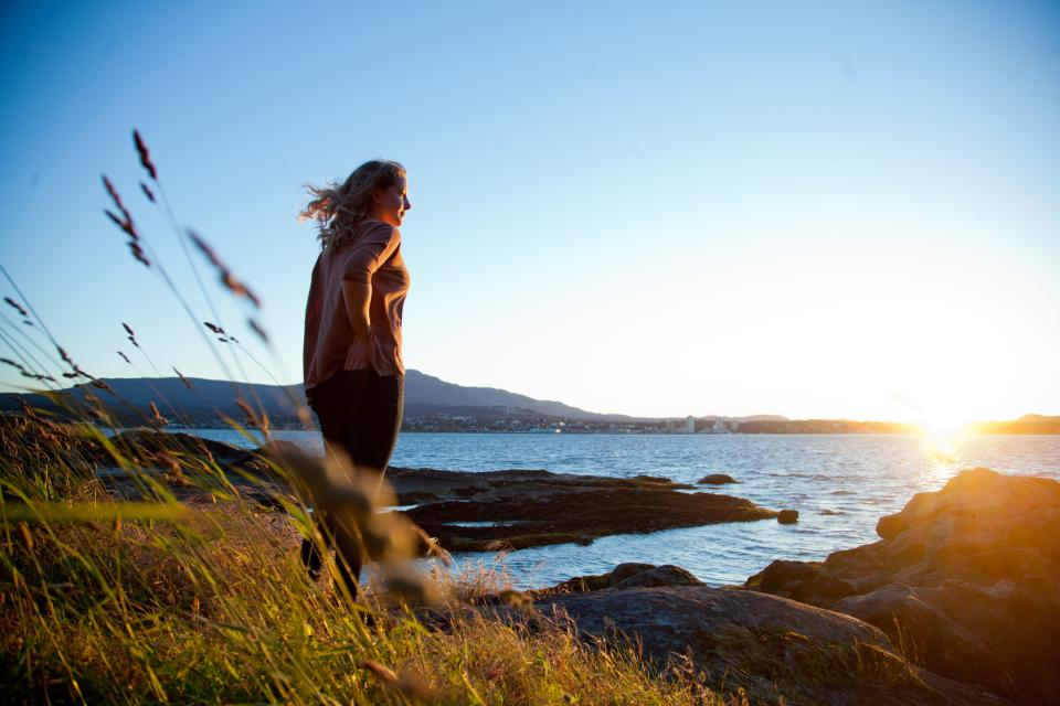 Student looking over Nanaimo - ocean view with sunset