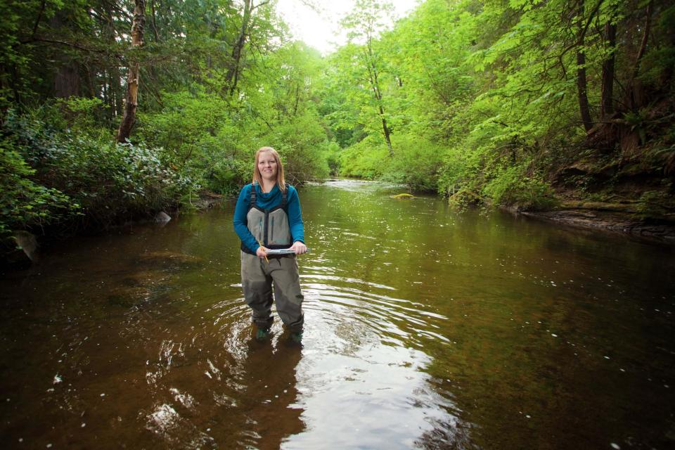 Erin Fulcher, a Bachelor of Science in Fisheries and Aquaculture student, taking water samples
