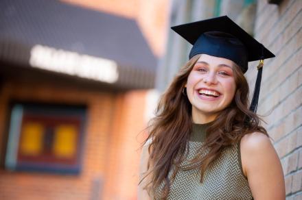 Portrait shot of Lurana wearing a grad cap