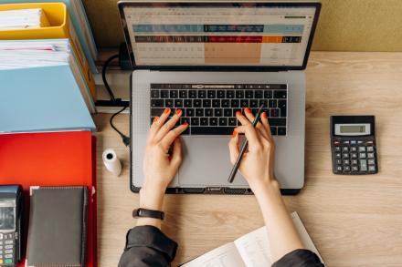 computer, hands typing, calculator