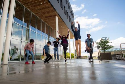 Students jumping outside the Health and Science Centre